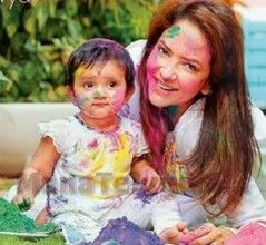 Lakshmi Manchu Happily Drenching her Little One in Colours