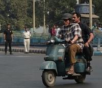 Spotted: Big B Riding A Scooter In Kolkata