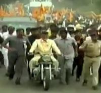 CM Chandrababu rides Bullet in Jana Chaitanya Yatra in Guntur