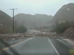 Driver Escapes from Flash Floods