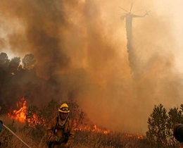 California wildfire guts 18 homes