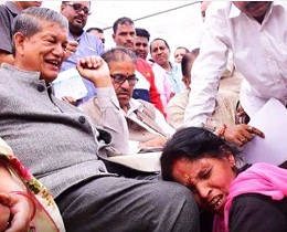 Harish Rawat laughs as weeping woman begs at his feet