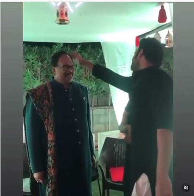 Video: Prabhas Taking Care Of Krishnam Raju's HairStyle!
