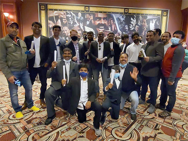 Pawan Kalyan fans in USA celebrate Vakeel Saab premiere in Lawyer dress