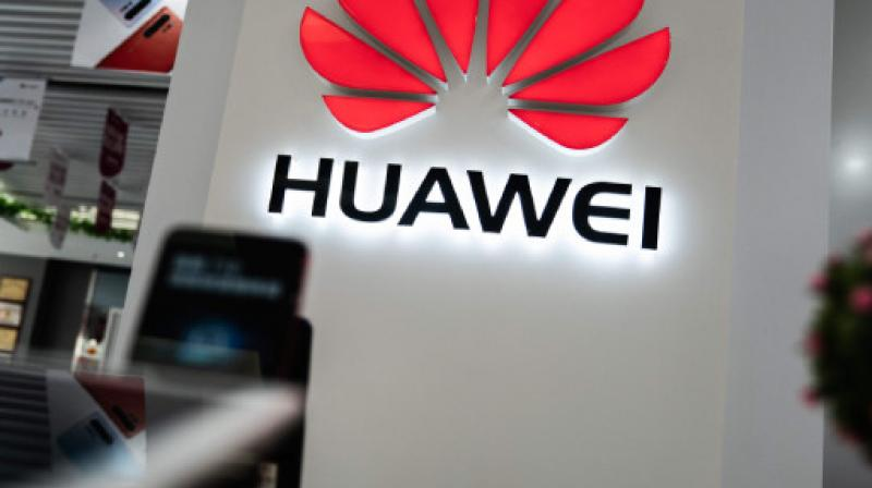 Huawei to launch new mobile operating system in fight for survival